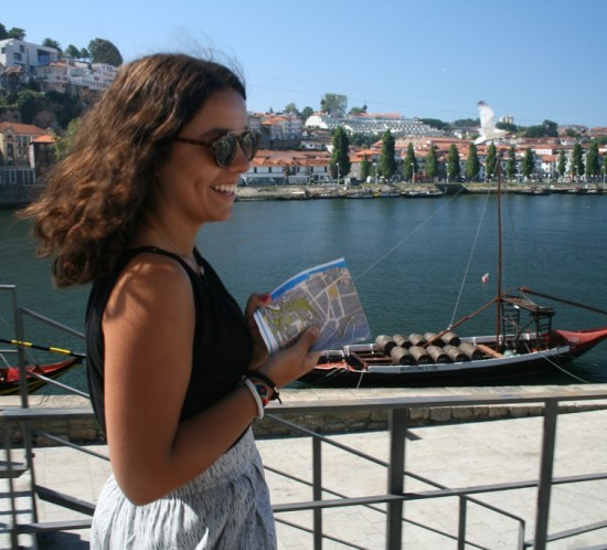 Woman holds a street map on a Porto walking tour